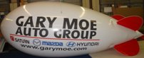 large advertising balloon - 17ft. blimp without lettering from $951.00 17ft. helium blimp with logo or lettering from $1320.00. Custom colors available!